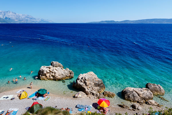 Beautiful Beach and Adriatic Sea with Transparent Blue Water near Split, Croatia by anshar