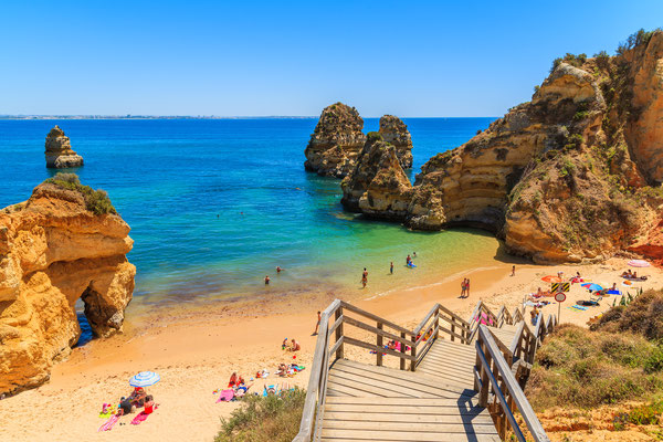 Wooden footbridge to beautiful beach Praia do Camilo, Portugal Copyright Pawel Kazmierczak