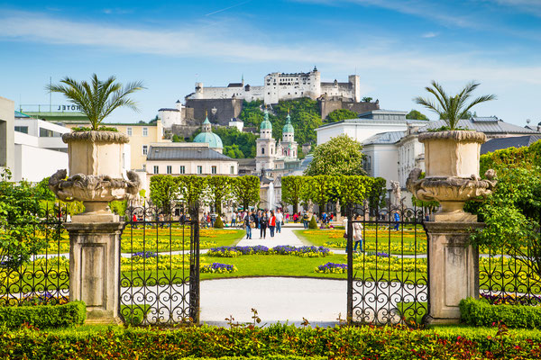 Beautiful view of famous Mirabell Gardens with the old historic Fortress Hohensalzburg in the background in Salzburg, Austria Copyright canadastock