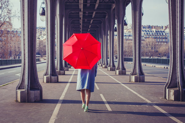 Fashion woman with red umbrella walking on the street in Paris - Copyright Ditty_about_summer