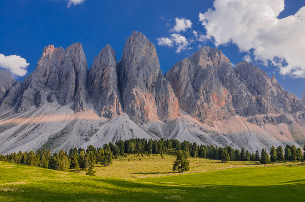Sunny afternoon view of Odle mountain group knife-edge peaks as taken from Malga Glatsch refuge in Puez-Odle Nature park, Funes valley, Dolomites, Trentino Alto Adige, Bolzano, South Tyrol, Italy Copyright Mo