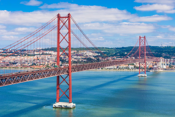 The 25 de Abril Bridge is a bridge connecting the city of Lisbon to the municipality of Almada on the left bank of the Tejo river, Lisbon Copyright saiko3p