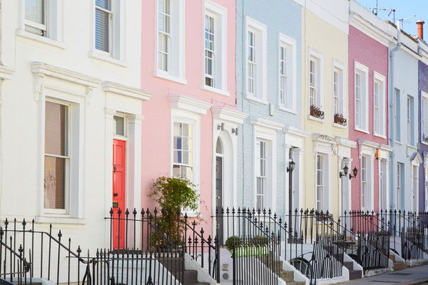 Colorful English houses facades, pastel pale colors in London Copyright andersphoto