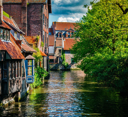 Bruges - European Best Destinations - Canal and Medieval Houses in Bruges - Copyright Dmitry Rukhlenko