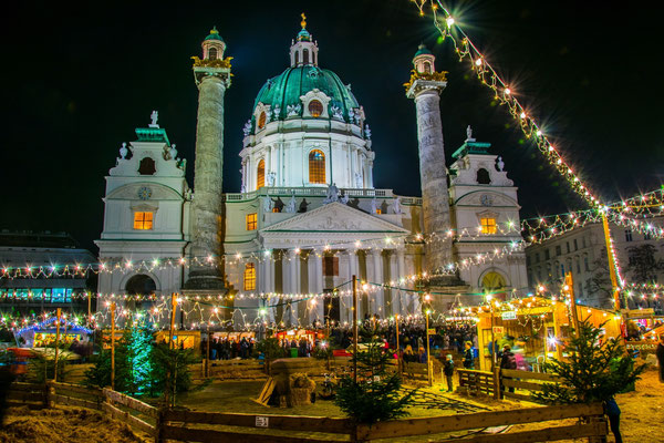 Christmas market taking place in front of the karlskirche in Vienna - By trabantos