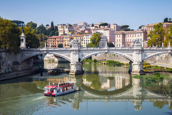 Small touristic boat goes to Ponte Vittorio Emanuele II, Rome, Italy - Copyright Eugene Sergeev