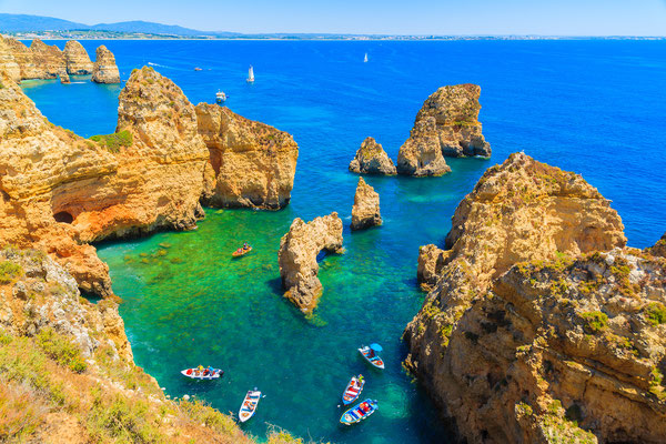 Fishing boats on turquoise sea water at Ponta da Piedade, Algarve region, Portugal by  Pawel Kazmierczak