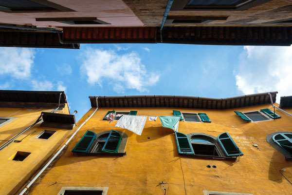 Hanging clothes on a beautiful building in Pisa, Italy - Copyright Sabino Parente