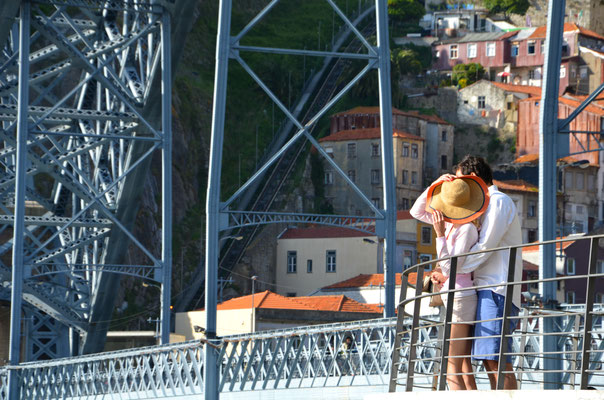 Lovers on the famous Luis I Bridge, Porto, Portugal © European Best Destinations