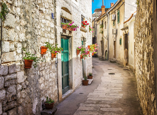 Narrow old street and yard in Sibenik city, Croatia, medieval zone by