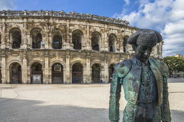 Roman Arena (Amphitheater) in Arles and bullfighter sculpture, Provence, France - Copyright Emanuele Mazzoni Photo