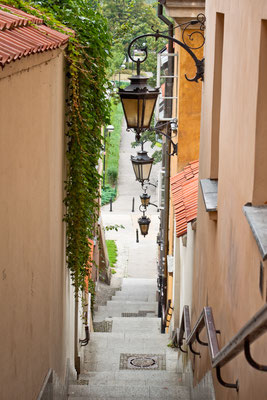 Narrow street with stairs and lamps in the Old town of Warsaw, Poland Copyright Anastasia Petrova