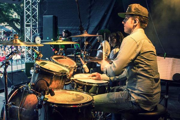 Drummer Alex Domhoever playing live at Reggae Jam festival in Bersenbrueck, Germany