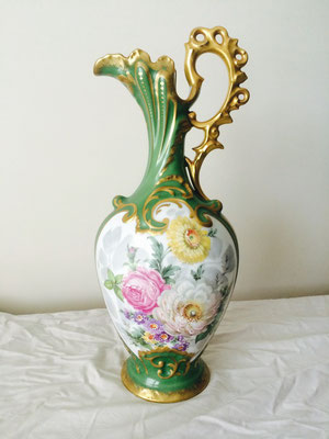 Limoges France decorative handed painted with sprigs of flowers on a green moulded back ground vase. Circa 1920 H 400 x D  155 mm $ 345.00