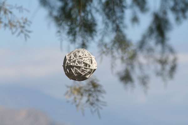 round white decoration hanging from tree