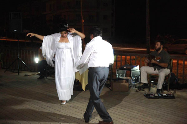 bride and groom dancing at their Greek wedding