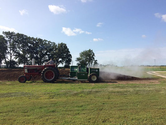 Turning the compost generates steam