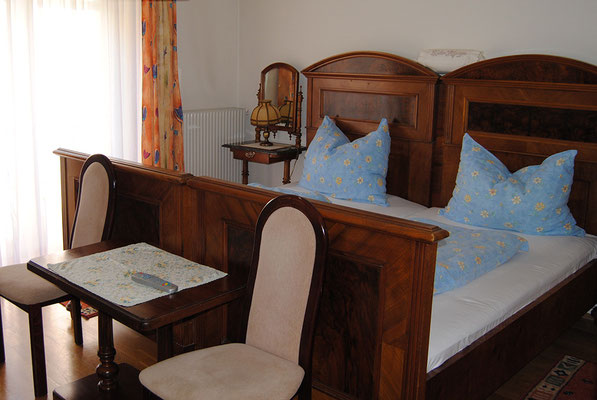 cozy double room with antique country bed and balkony at Pension Kirchenwirt, Obervellach