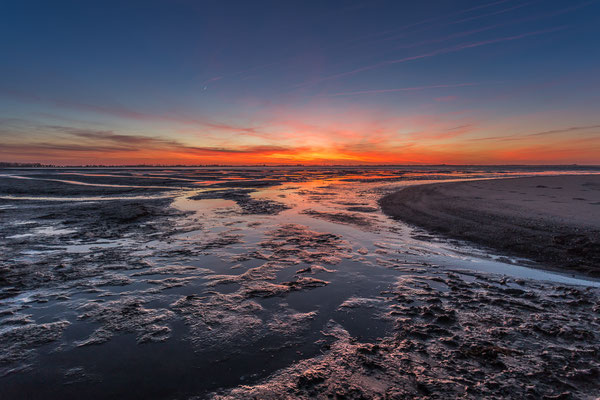Sonnenuntergang im Watt vor Hooksiel