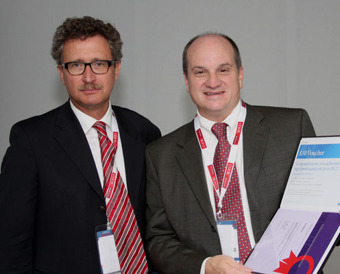 Most Downloaded Article in 2012: From left to right: Prof. Vorwerk (Past CVIR EiC), Prof. Walser (awardee)