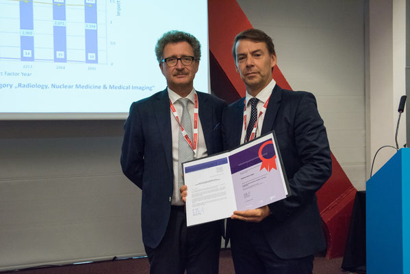 Most Downloaded Article in 2015: From left to right: Prof. Vorwerk (Past CVIR EiC), Dr. Paul Lohle accepted the award on behalf of the author