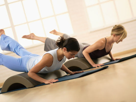 Pilates avec arc barrel