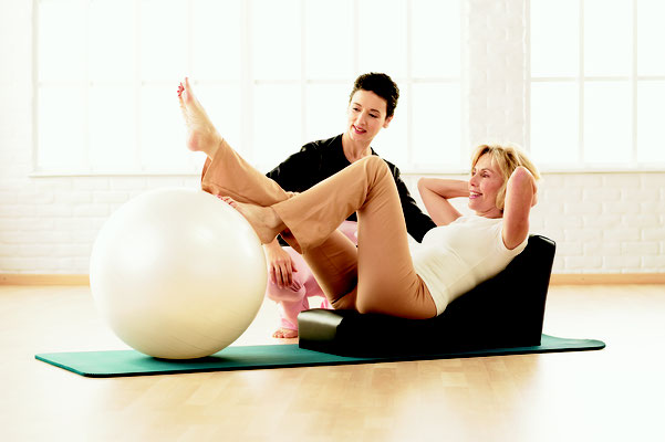 Pilates avec Spine supporter