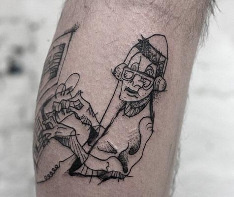 abstrakt comic tattoo