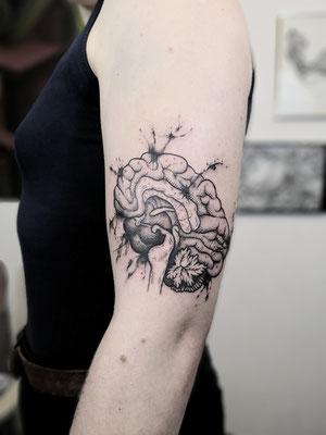 brain blackwork tattoo