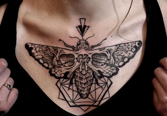 dark moth skull geometric tattoo