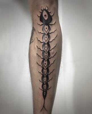 millipede dark blackwork tattoo
