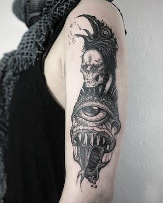 dark skull blackwork tattoo evil