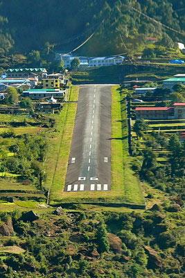 Het gevaarlijkste vliegveld ter wereld: Lukla op 2850 meter hoogte.