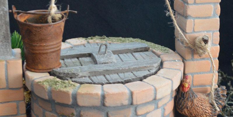 Het deksel maakte ik van foam - beplakt met dunne stukjes hout - het greepje is een krammetje