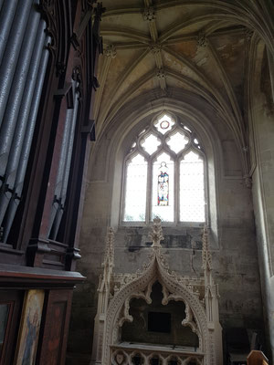 Windows of church show three versions of 13th and 14th century Decorated