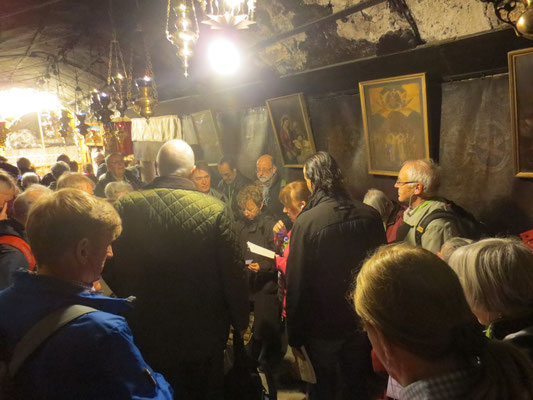 Our group reading oppotiste the grotto
