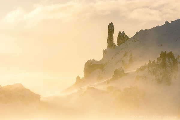 The spires of Bræðrafell in backlit blowing snow.