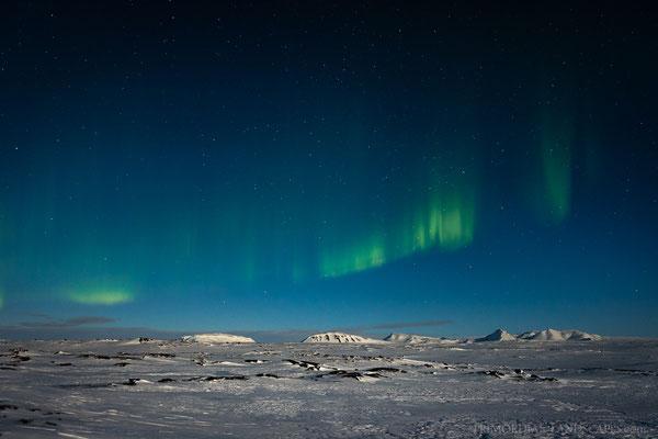 Moonlit landscapes and dancing Aurora above the Hvammfjöll