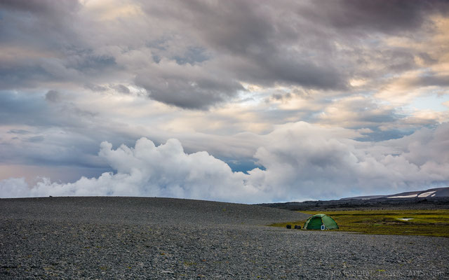 Tiny tent and big clouds.