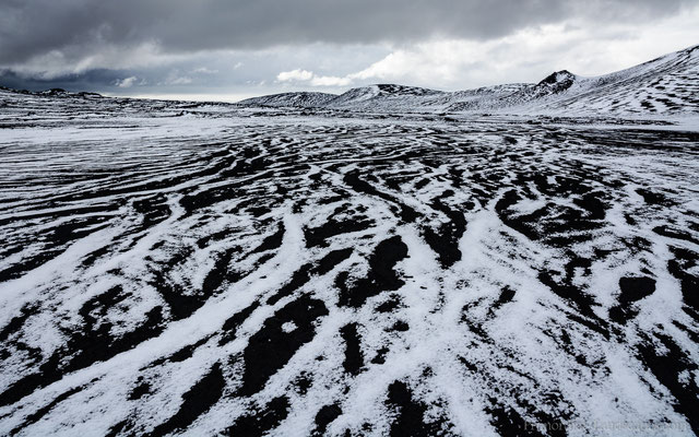 The contrast of erosion grooves and fresh snow