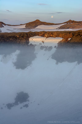 The pit craters filled with fog during the night and again in the early morning.