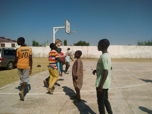Elijah Playing Basketball with Some Nigerians