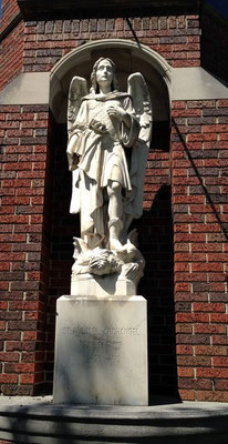The statue at the corner of the building still remains.