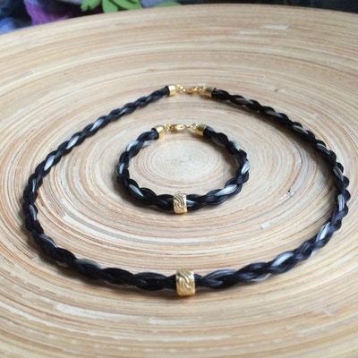Halskette und Armband aus je 4 Strängen rund geflochten mit Zwischenelement aus 925-silber vergoldet