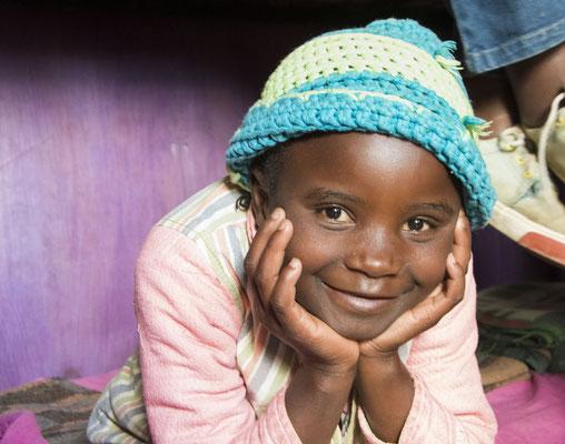 Lächeln beim gemeinsamen fotografieren mit Kindern