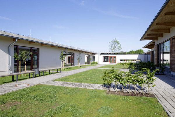 Flache freundliche Bauten schaffen Behaglichkeit