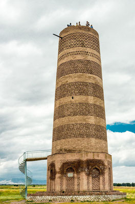 Burana tower, a large minaret in the Chuy Valley in northern Kyrgyzstan. It is located about 80 km east of the country's capital Bishkek, near the town of Tokmok