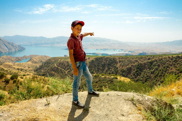 a boy point on the Nurek reservoir