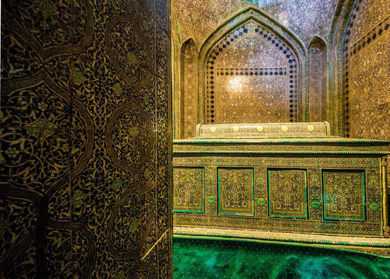a smaller chamber containing the tomb of Pakhlavan Mahmoud himself. The crypt can be seen through the portals of two elaborate wooden doors inlaid with ivory, coral and copper