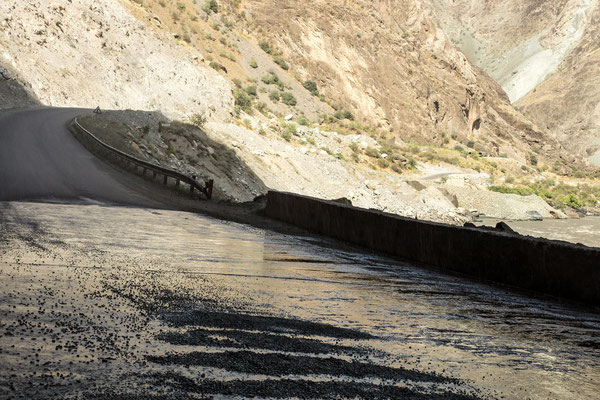 under a natural carwash station: a mountain stream flowing over a rock ledge